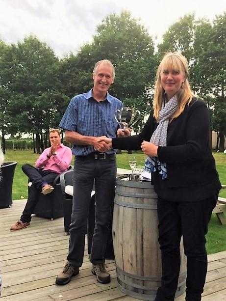 SEVA General Secretary, Belinda Mercer, presents Bluebell Vineyard Winemaker, Kevin Sutherland, with SEVA cup for best sparkling wine.