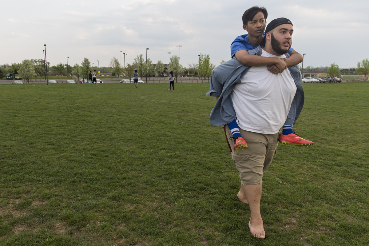 Josh carries Ehlerh out onto the field for Karen soccer practice at Buckland Park in Brighton, N.Y.. Although Josh does not play soccer with the boys, he hangs out at almost every practice and scrimmage. May 9, 2015.