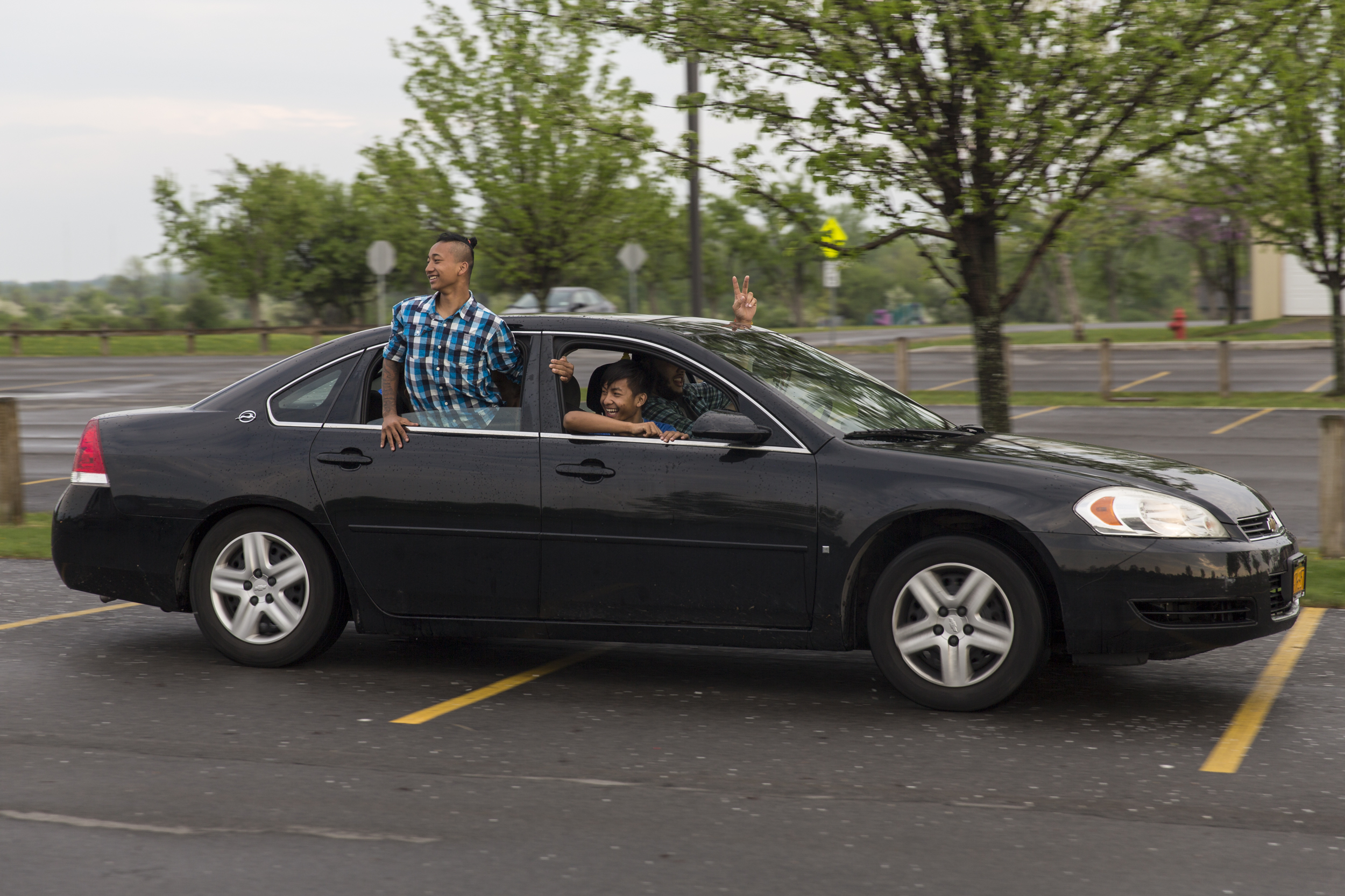 (from left) Hsar and Ehlerh look back as they race other players' cars on the way out after practice at Buckland Park in Brighton, N.Y.. Since the boys do not have their licenses or cars, they often rely on Josh or others to give them a ride to practice. May 10, 2015.