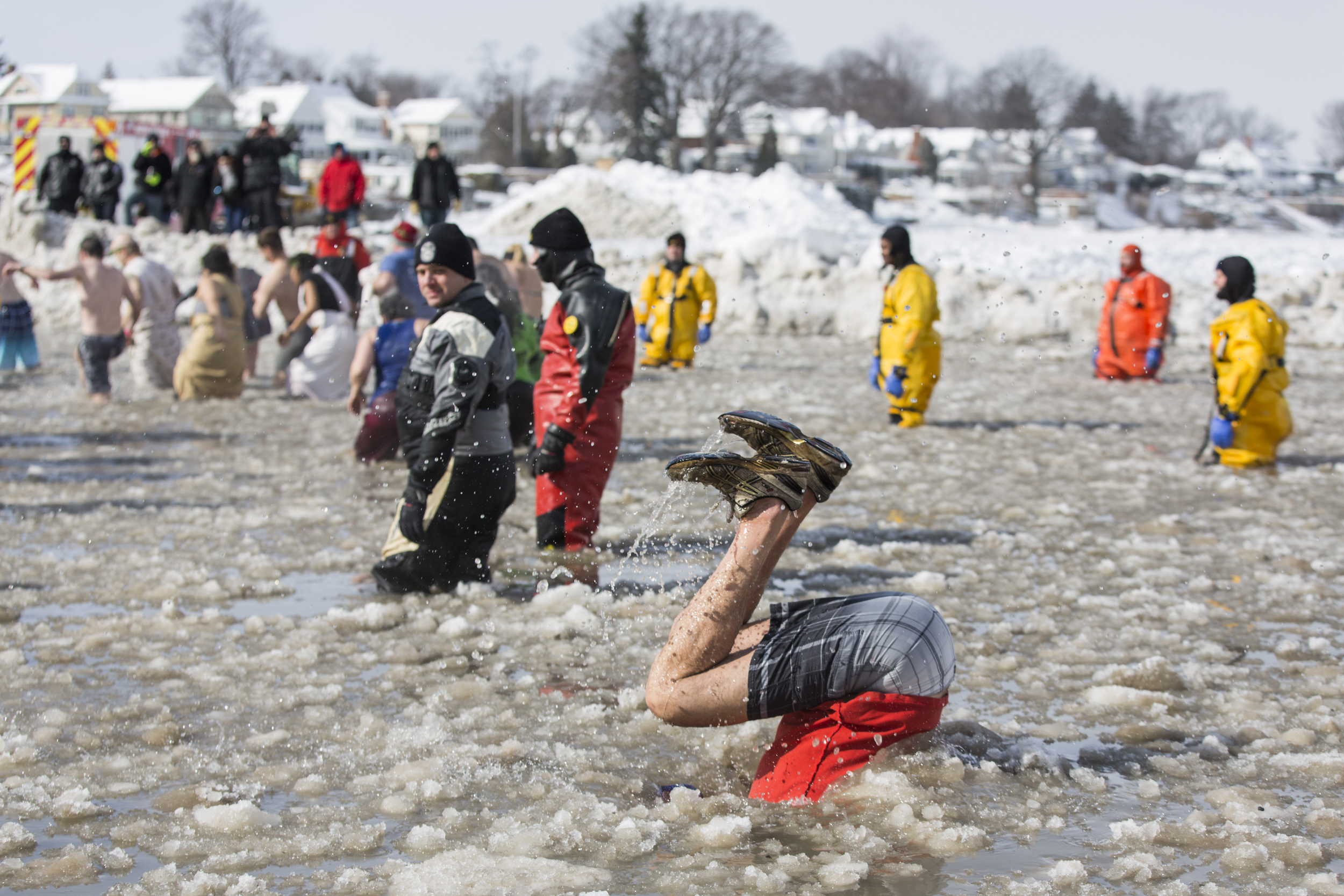 A participant somersaults into the cold waters of Lake Ontario at Polar Plunge at Ontario Beach Park in Rochester, NY on Feb. 14, 2016. Polar Plunge is an annual event where participants run into a body of water despite the cold temperatures of winter as a fundraising and awareness initiative to benefit the athletes and programs of Special Olympics New York.