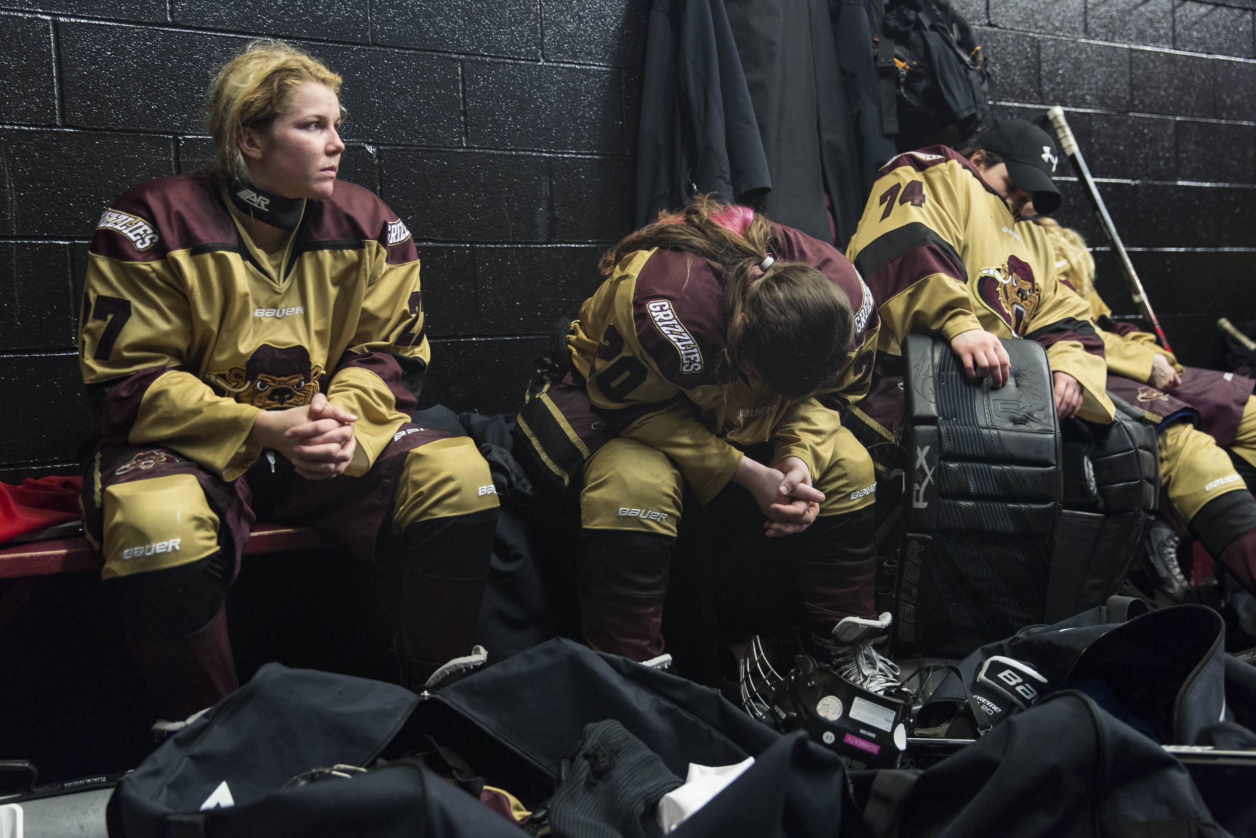 (from left) Shanley Austin and her Rochester Grizzlies teammates, Lexi Firkins and Serena Angelo, rest after the second period of their first tournament game against Troy-Albany on March 6, 2015 at Bill Gray's Regional Iceplex in Rochester, NY. Troy-Albany scored in the late minutes of the second period to take a 1-0 lead.