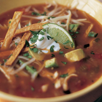 Mexican Chicken Soup - Here's the recipe. Health tip: Bake the tortilla strips instead, they get really crispy on their own, without added oils.