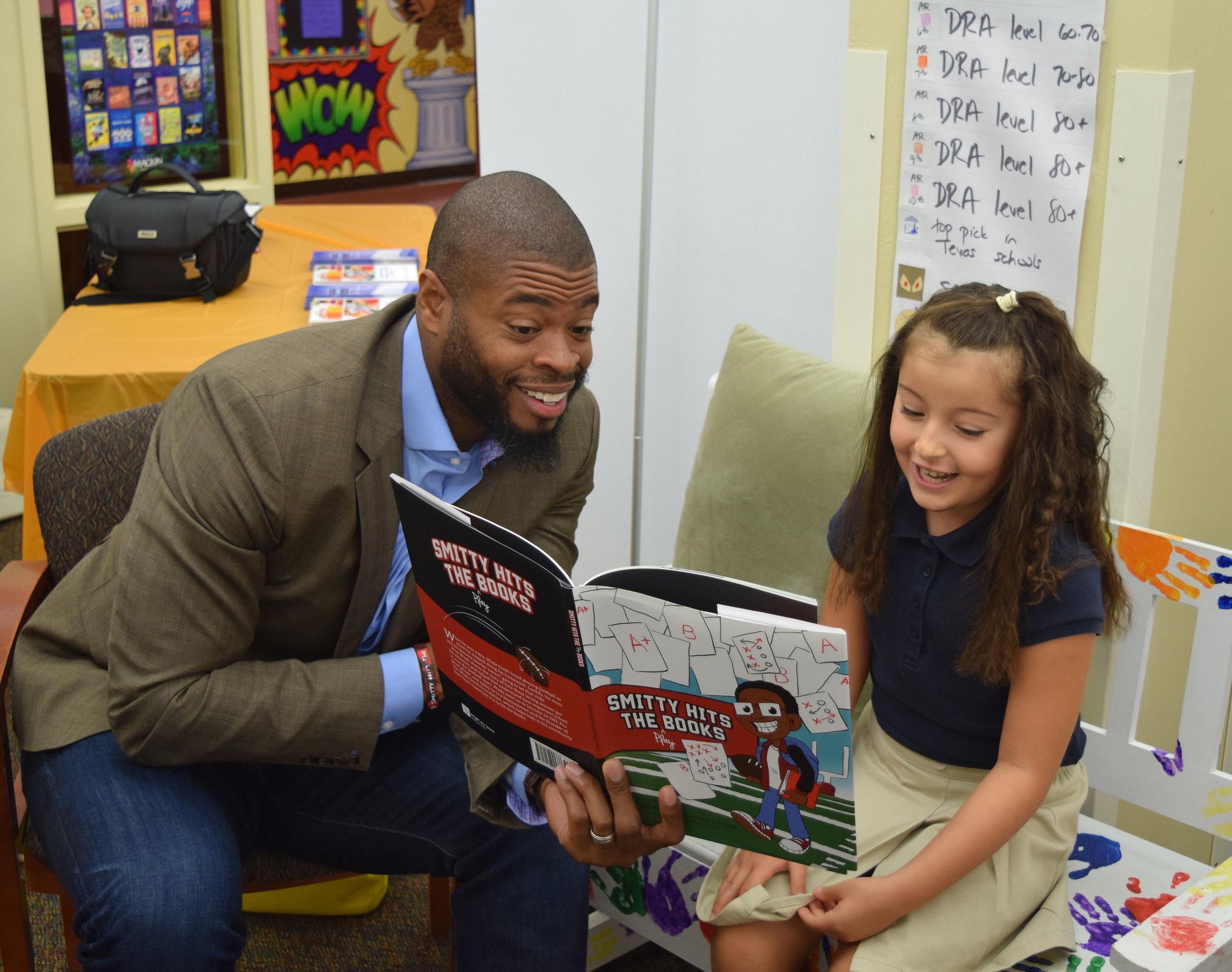 Wade and Daniella reading  Smitty Hits the Play Books  at Walnut Bend Elementary in HISD