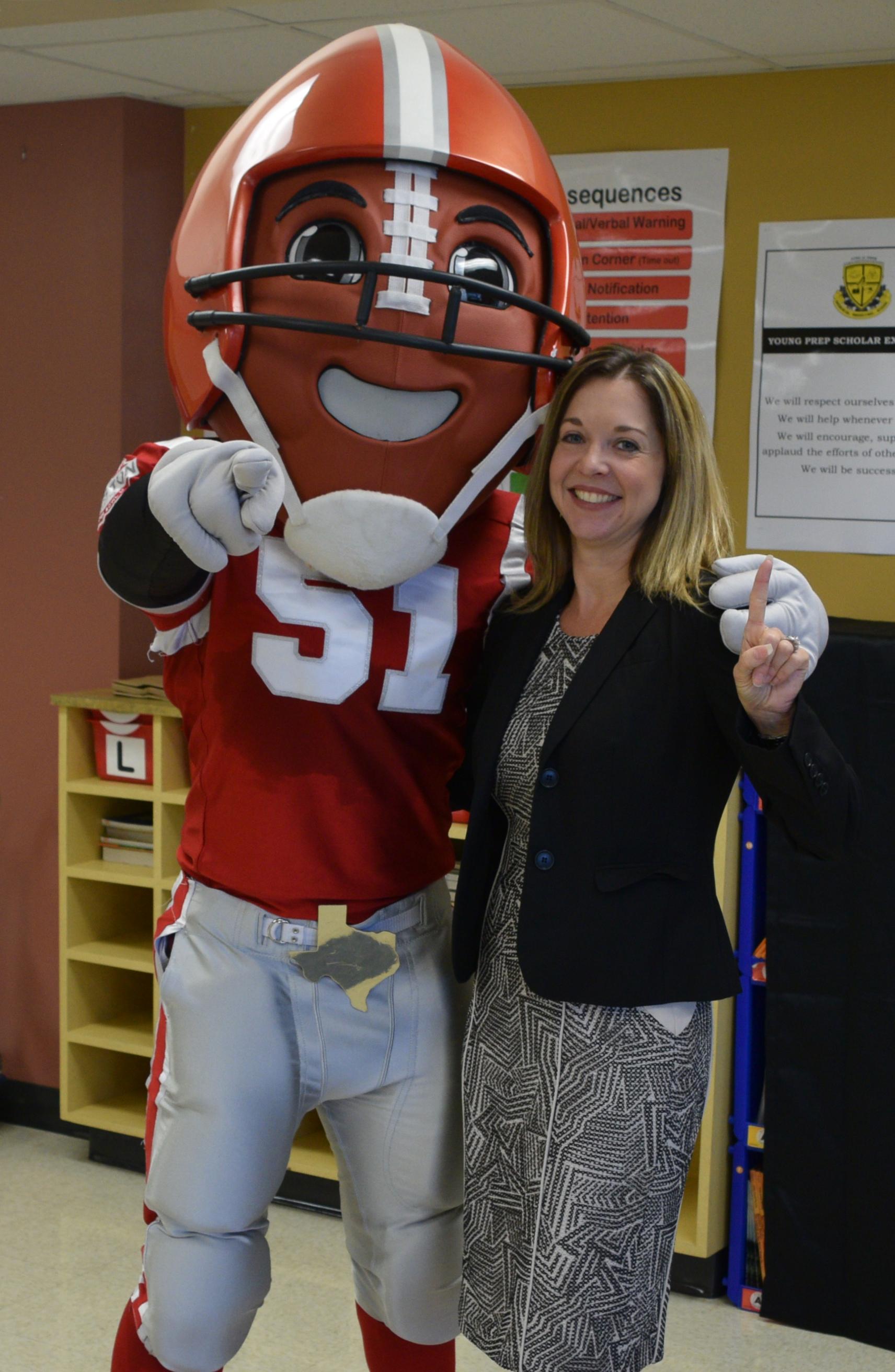 "Super Bowl Host Committee mascot ""TD"" with Foundation President Dr. Julie Baker Finck."
