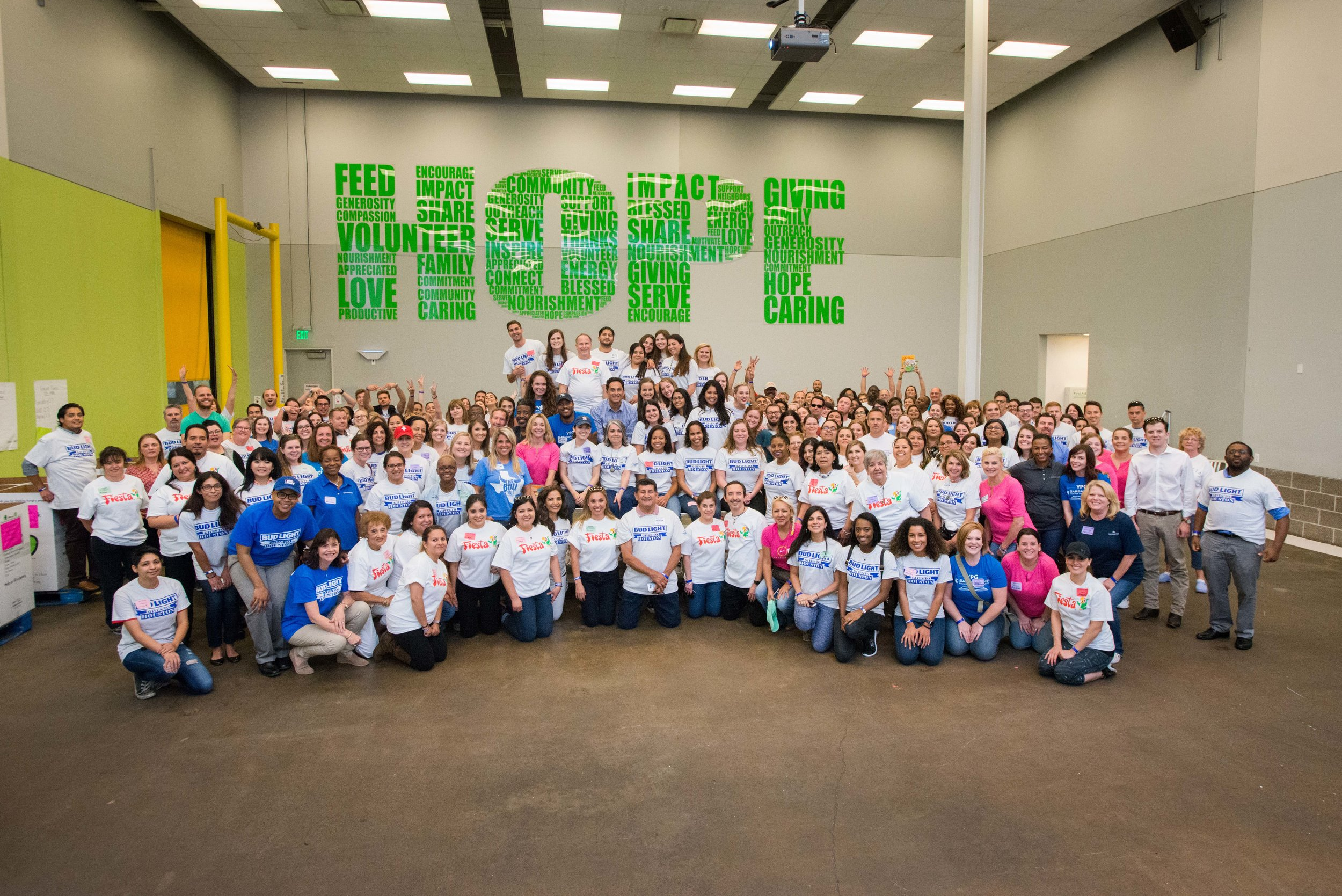 Volunteers gather for photo at the Bud Light Gives to Houston event.