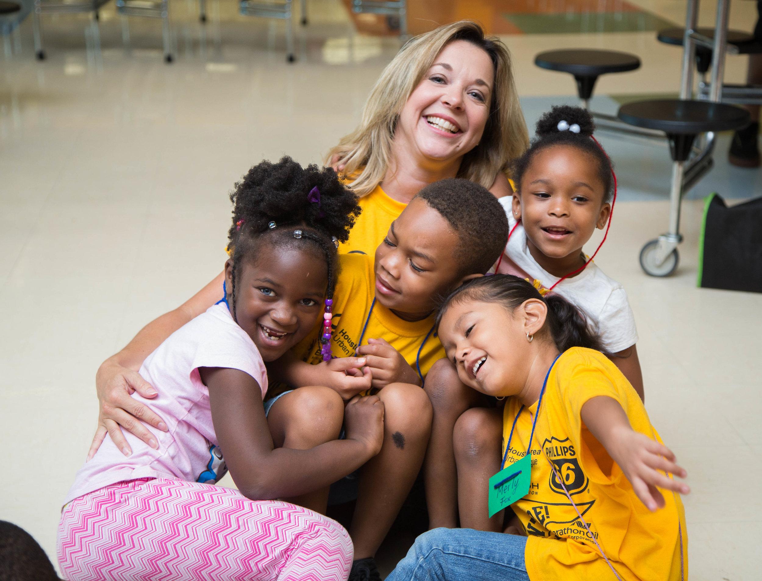 Dr. Julie Finck with a group of children attending Camp Adventure!