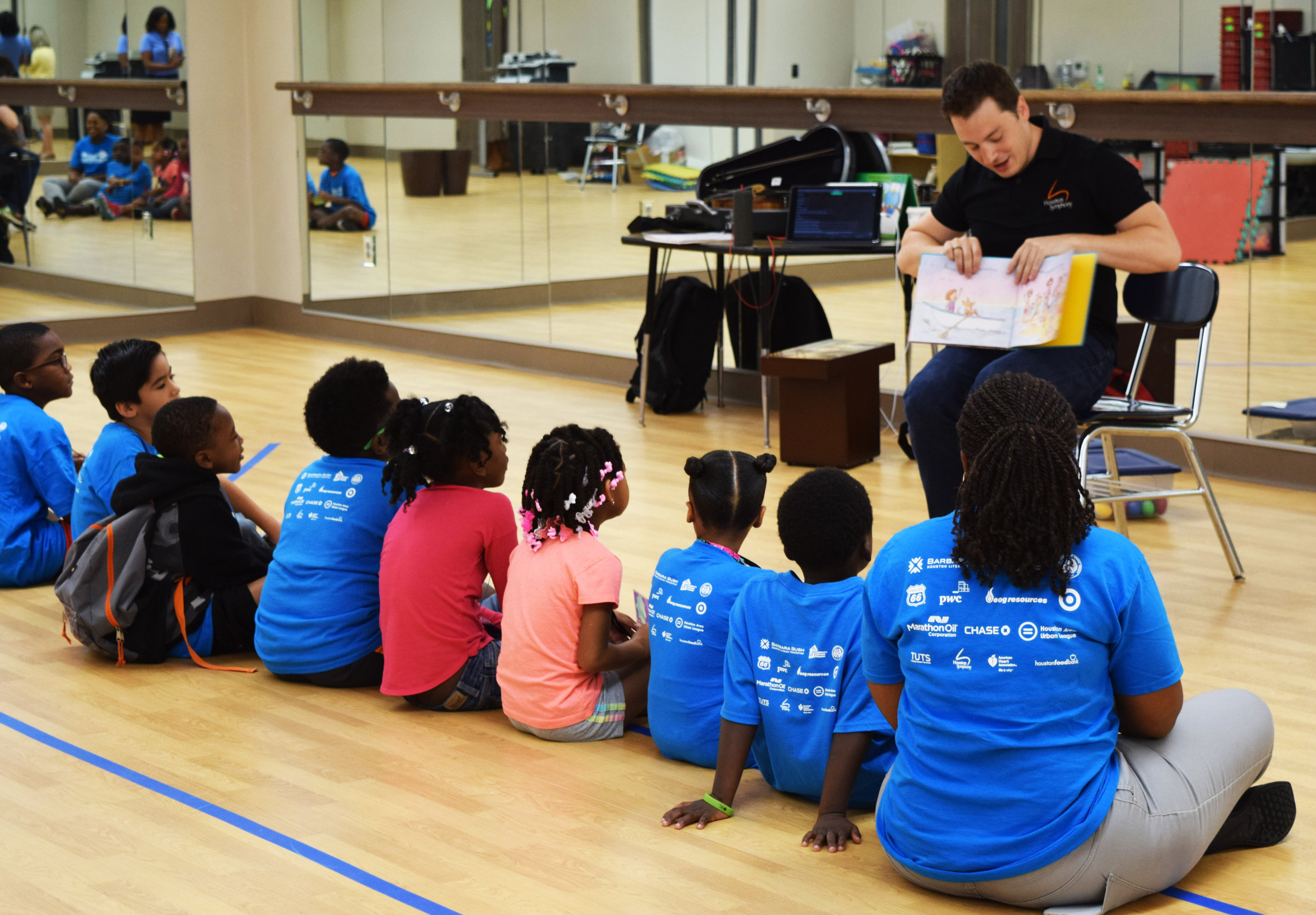 Tony Parce with the Houston Symphony reads to a group of children at Camp Adventure!.JPG