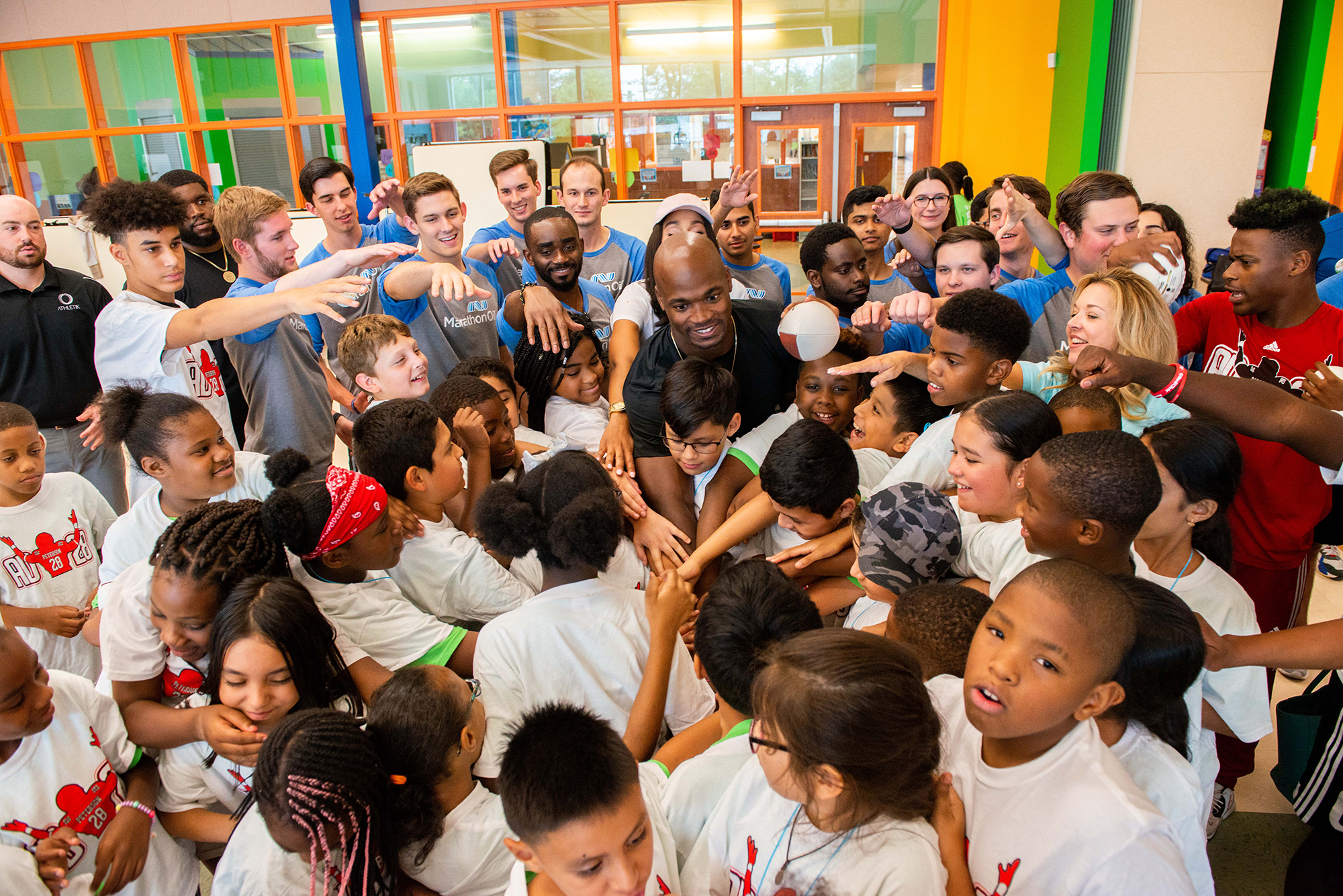 Adrian Peterson huddling up at Camp Adventure!; Photo by Michelle Watson.jpg