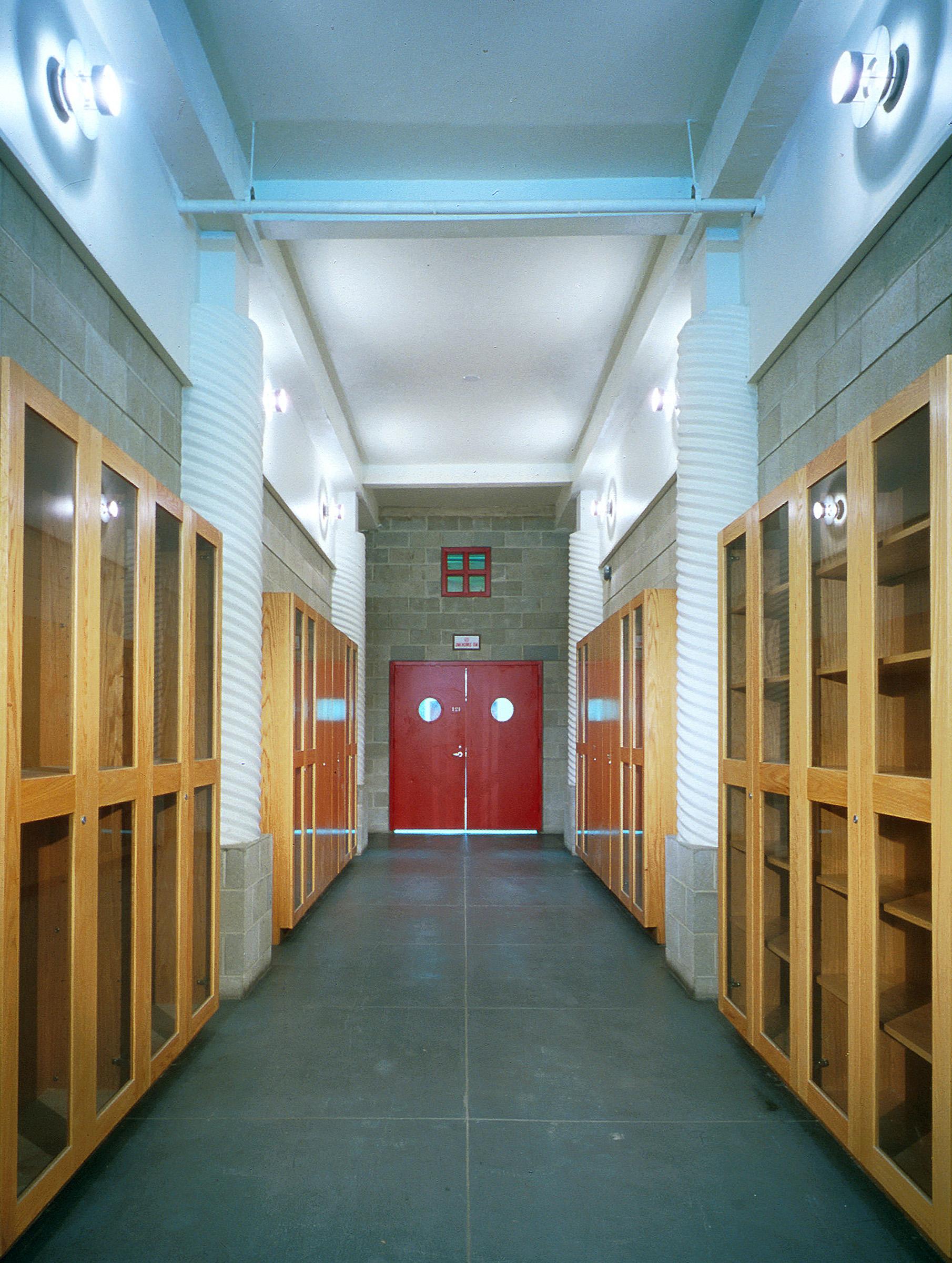 Com&Go - Interior - Hall with Glass Shelving.jpg