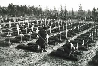 Tending graves at Abbeville, France, 1918