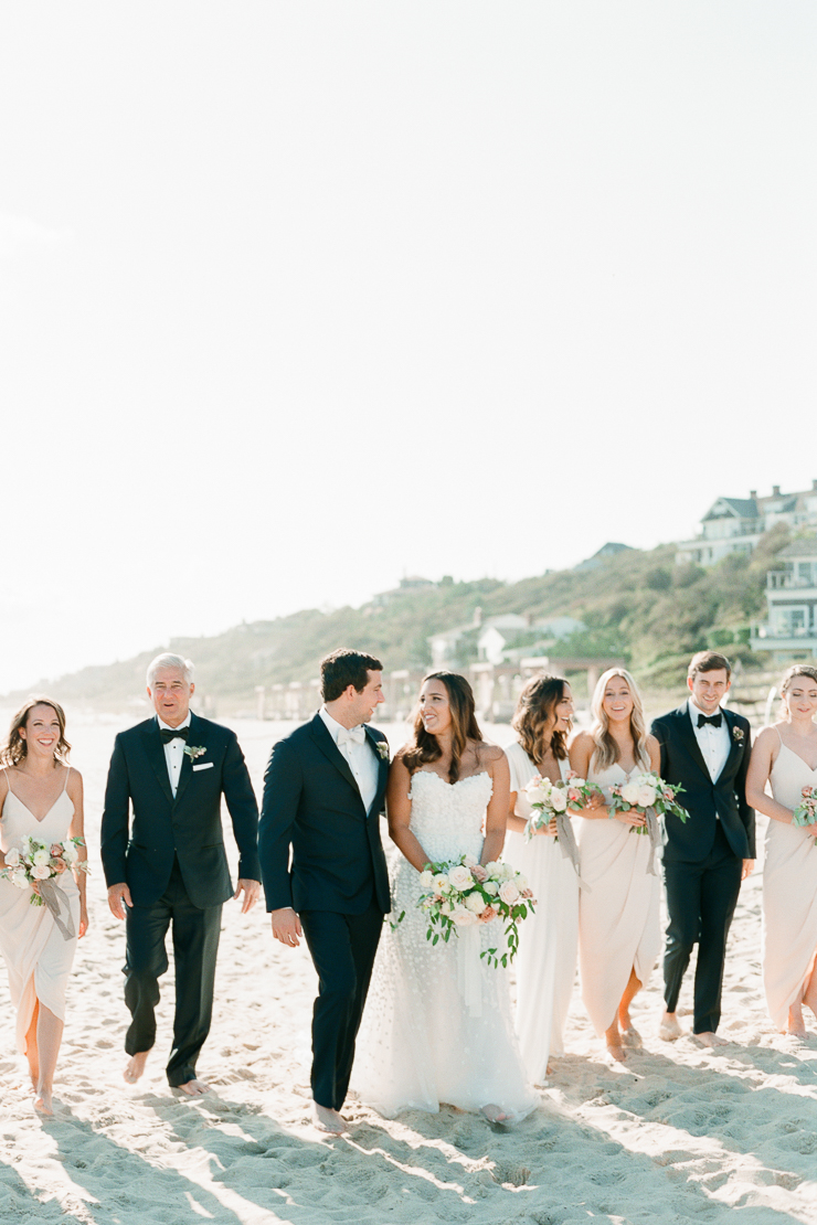 Bride and Groom walking on Beach with Bridal Party in Montauk, NY