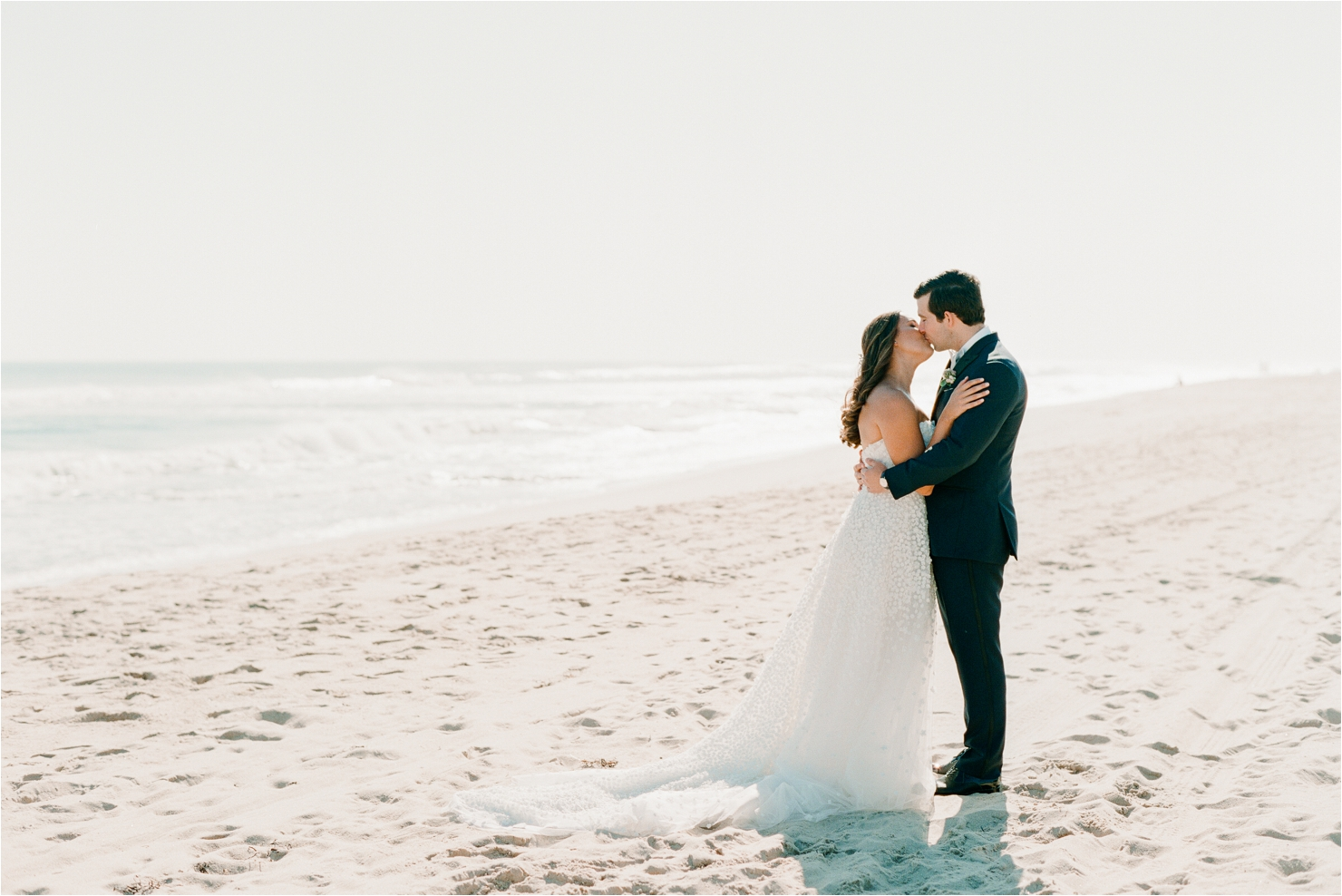 Bride and Groom Kissing on Beach Gurneys Montauk Wedding Photos