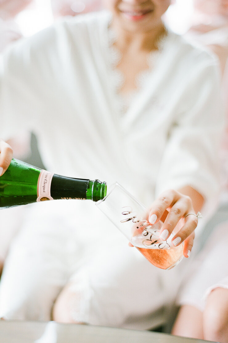 Bride Pouring Champagne on Wedding Day
