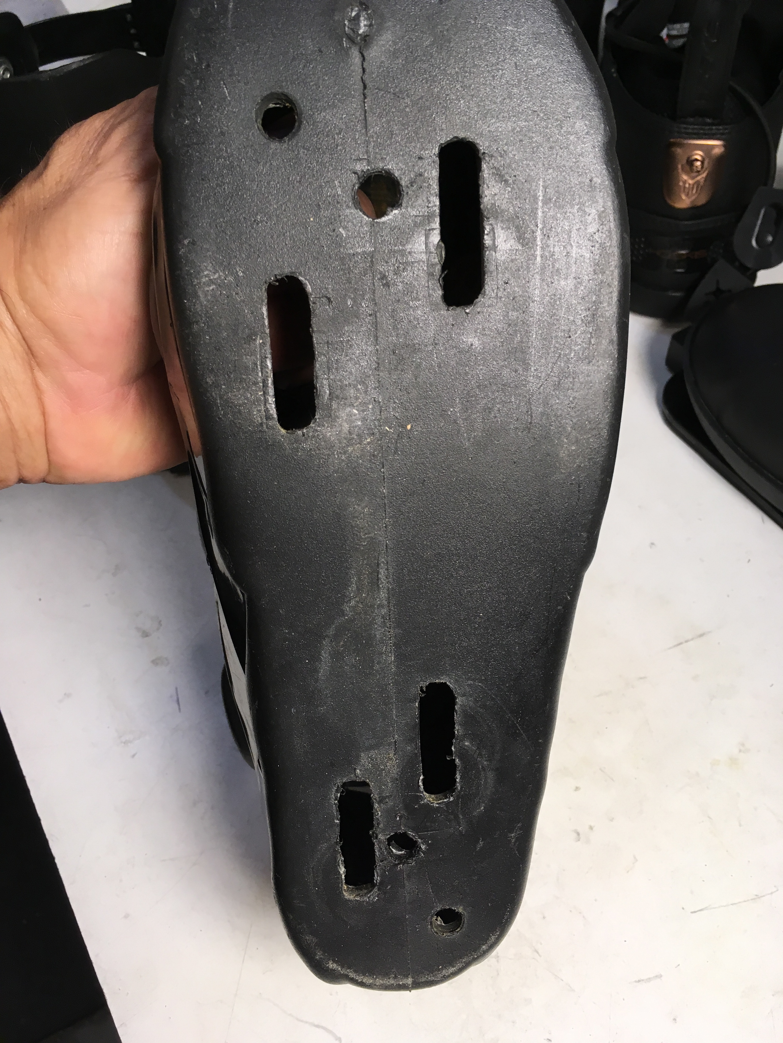 Mounting slots in bottom of boot.