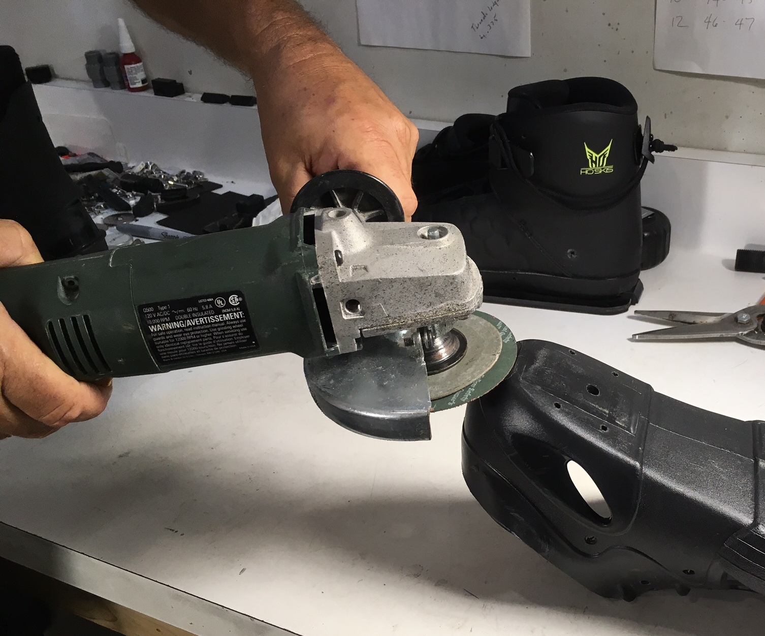 Use grinder w/ sanding pad to trim boots.