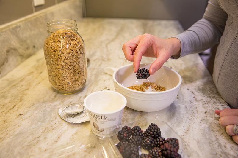 adding-berries-to-oatmeal.jpg