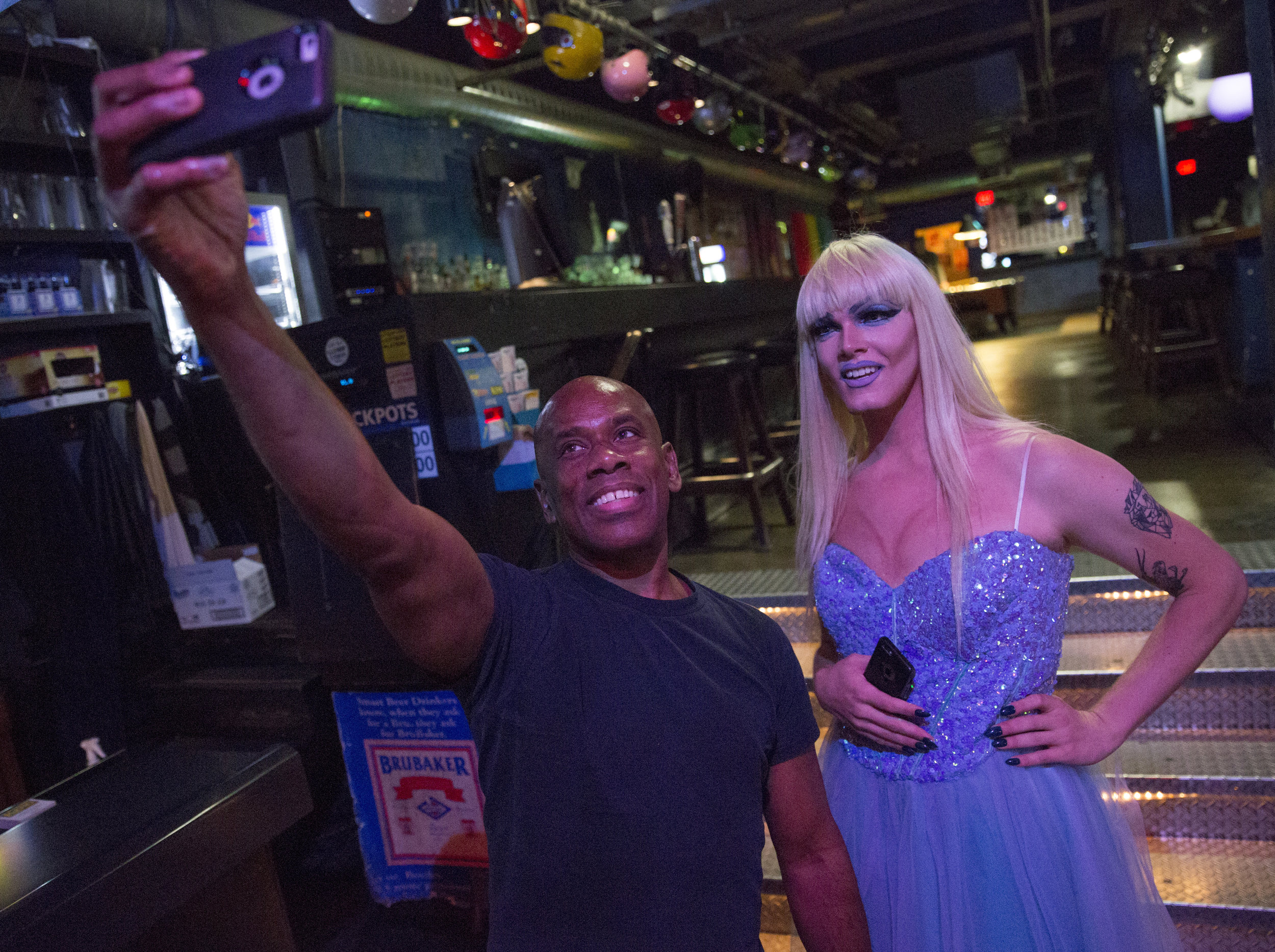 Ophelia poses for a selfie with a Machine Nightclub bartender.