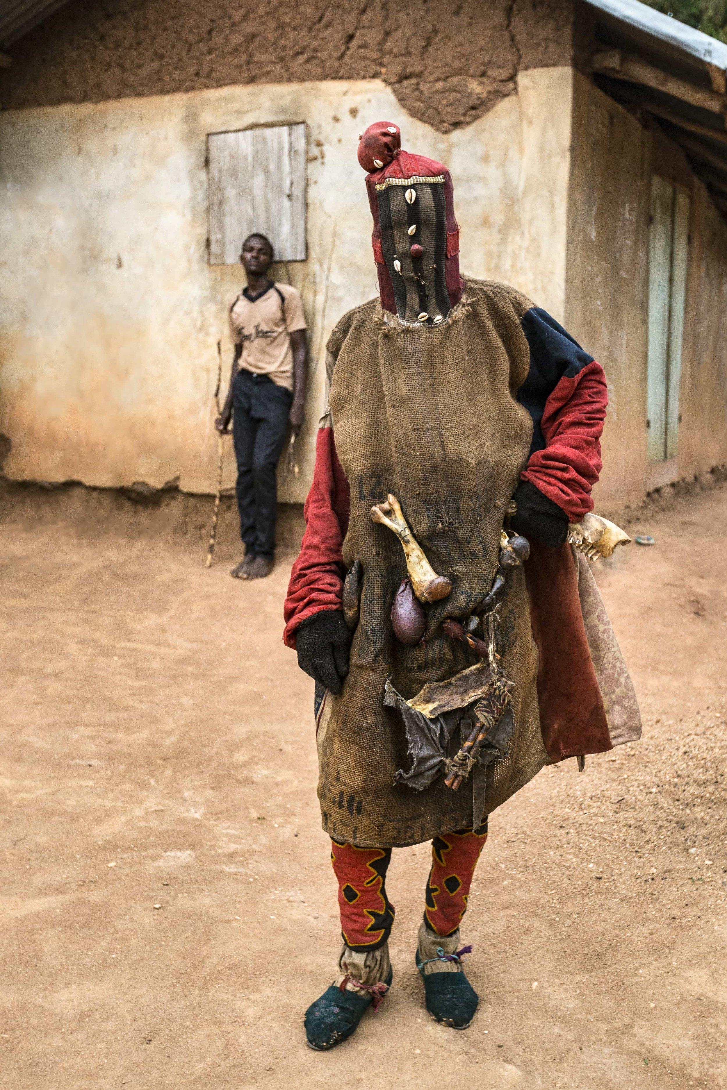 Portrait of a masqueraded Egoun Goun spirit at a Voodoo ritual ceremony.