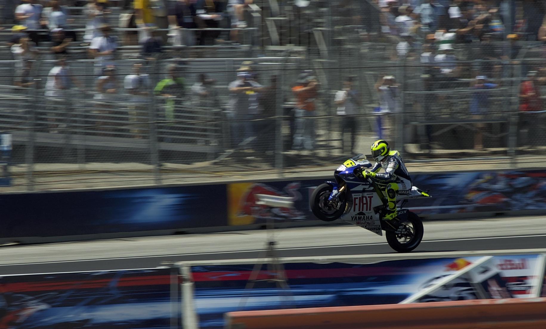 Rossi wheelie happy to get 4th.