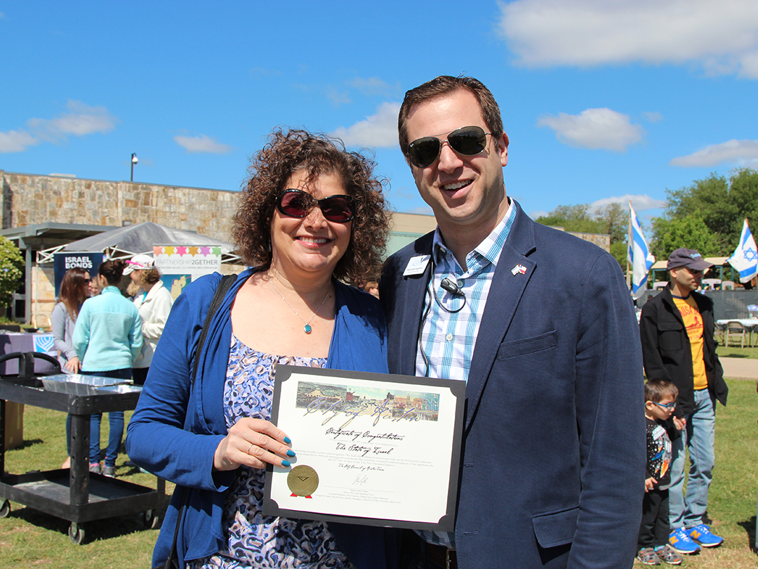 District 10 Council Member Alison Alter with Shalom Austin CEO Rabbi Daniel Septimus issues proclamation from the city of Austin officially recognizing April 22, 2018 as Israel at 70 Day. Credit: Wendy Goodman