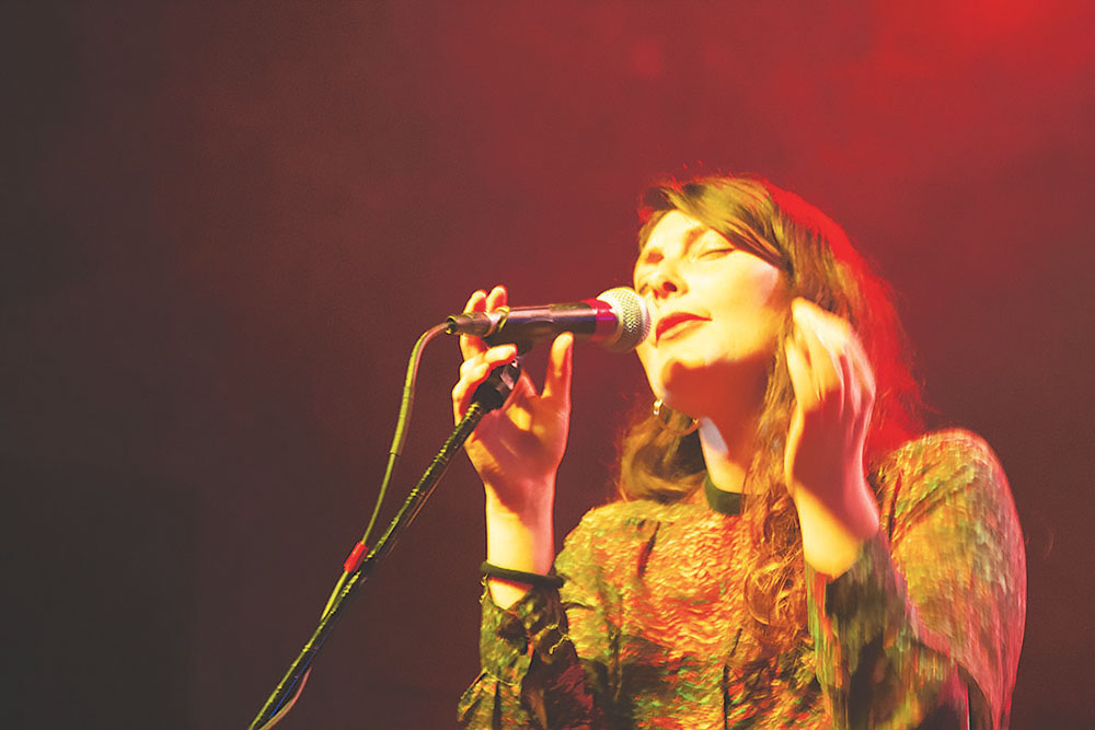 Jenia Vasilenko of JonZ performs on stage at the Parish March 12 for the Oy Vey! music showcase. Credit: Wendy Goodman