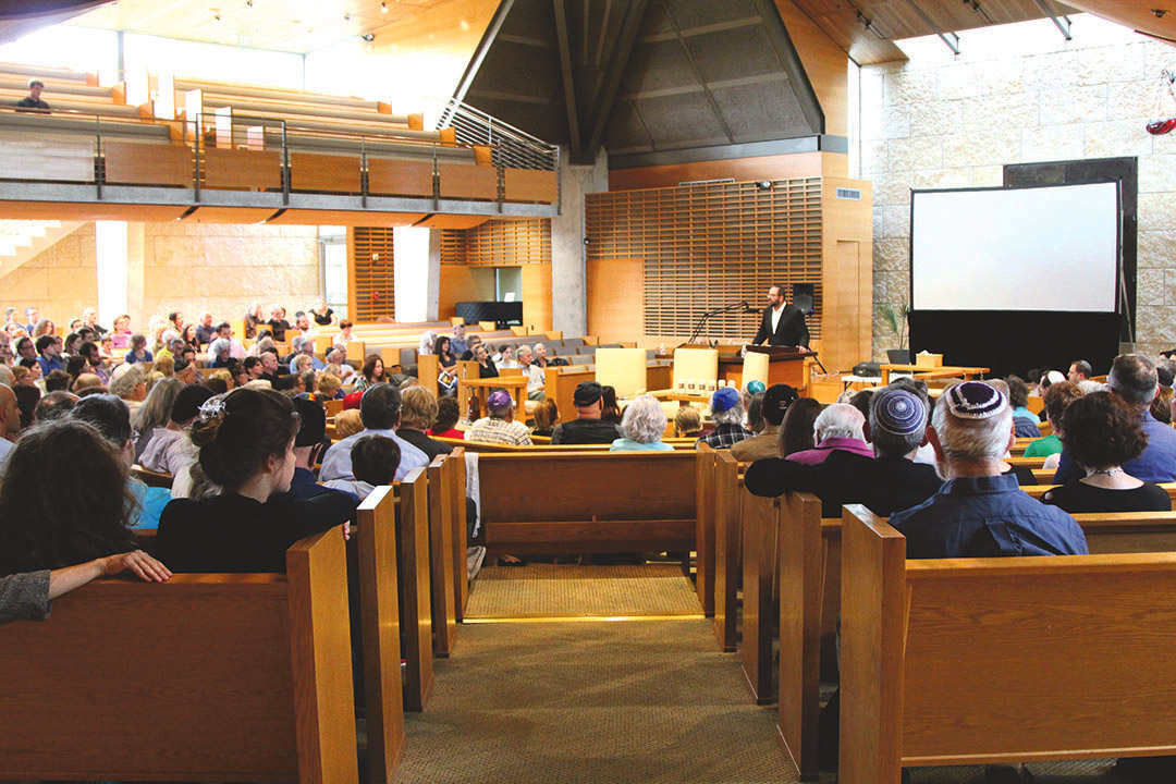 The community gathers at Congregation Agudas Achim May 1 for Yom HaShoah.  Credit: Wendy Goodman