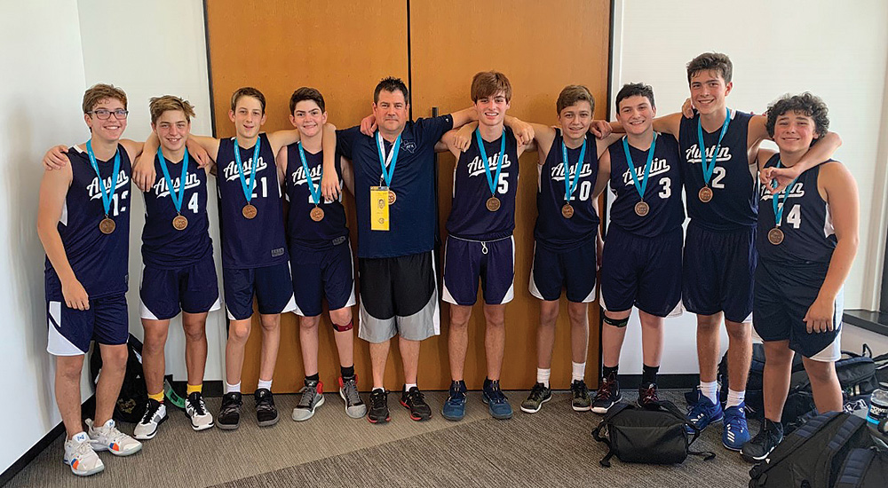 Team Austin 14U Boys Basketball and their Coach Bobby Schwartz with their bronze medals. Credit: Aron Waisman.