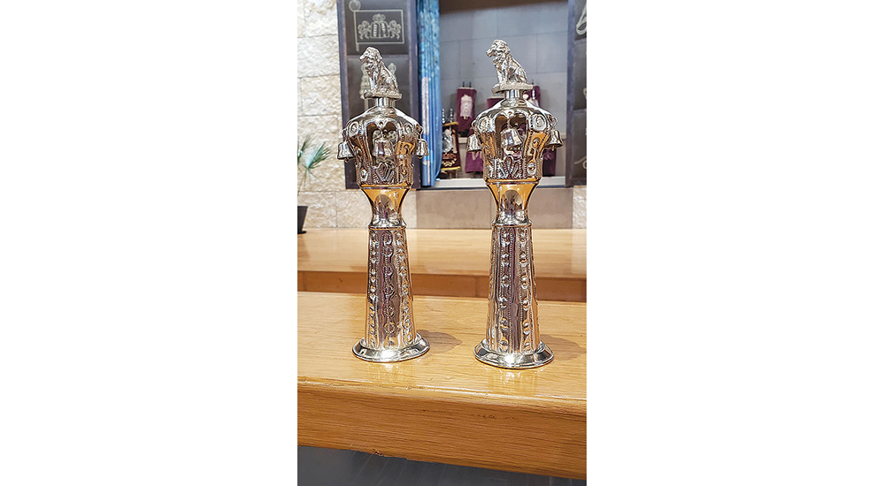 Restored silver rimmonim (Torah decorations) including new lion finials, replacement bells, and repaired body. Credit: David Finkel Photography.
