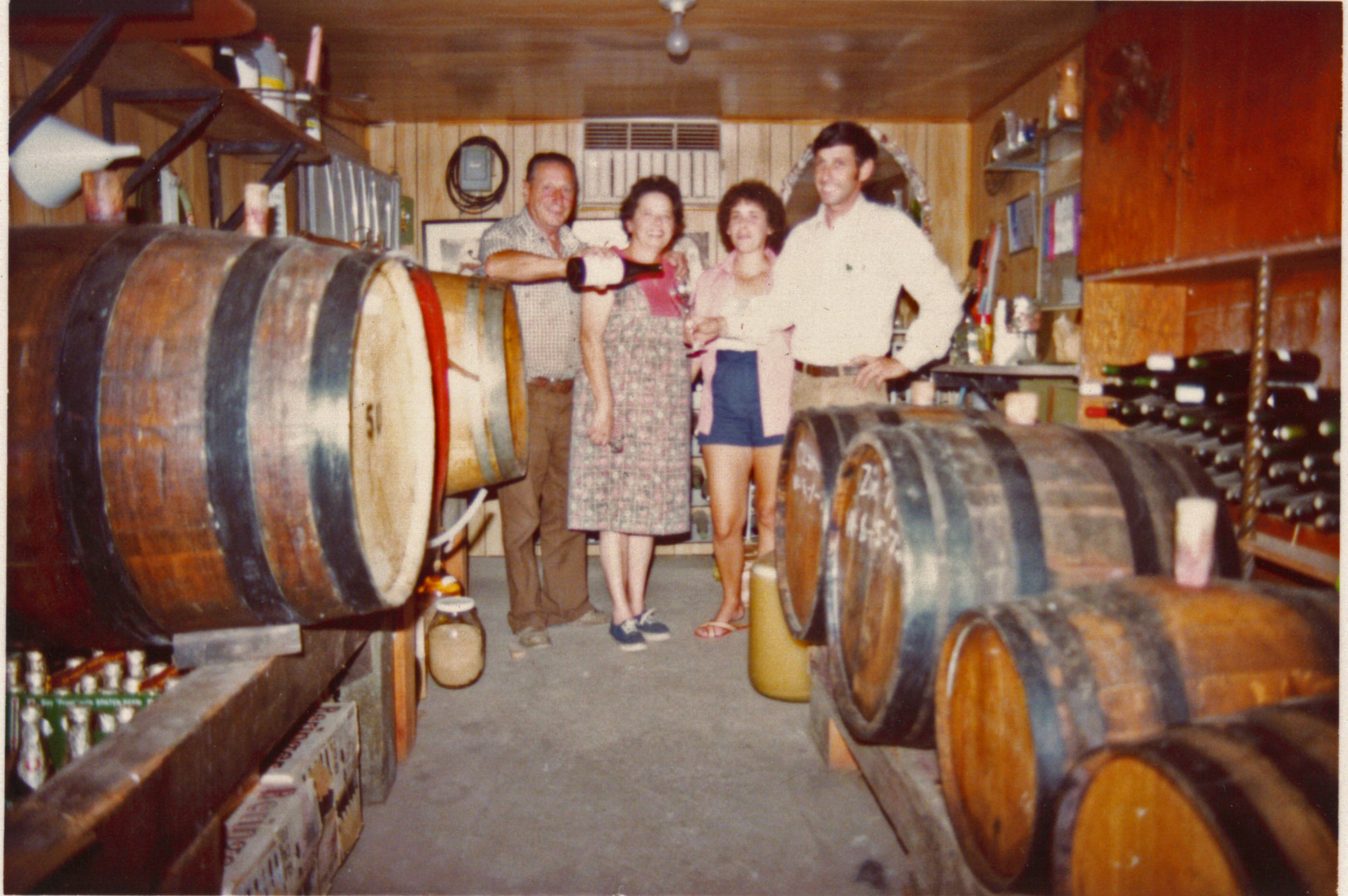 Eugene, Anna, Frances, and Emil Tedeschi in their family cellar.