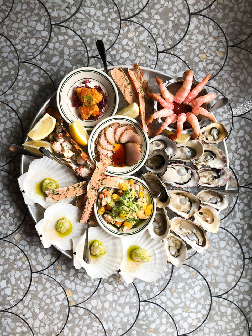 COQUILLE FINE SEAFOOD NOW OPEN IN THE HEARTOF Gastown - FEBRUARY 13, 2018The winning team behind Gastown's L'Abattoir has officially opened the doors of Coquille Fine Seafood, its latest venture located only a stone's throw away at 181 Carrall Street.Open for lunch, dinner, and late-night drinks seven days a week, Coquille (French for 'shell') serves up a bounty of fresh-caught seafood and shellfish dishes, a selection of hot and cold small plates, salads, sandwiches and crudos, seafood platters, and mains featuring the best of local land and sea.The beverage program, features an array of local craft beer, house-made cocktails, and a notable list of BC and international wines. Check out their website. Read more.
