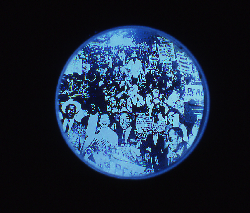 Power to the People I   (lens detail),2000,  LED lit collage seen through reduction lens