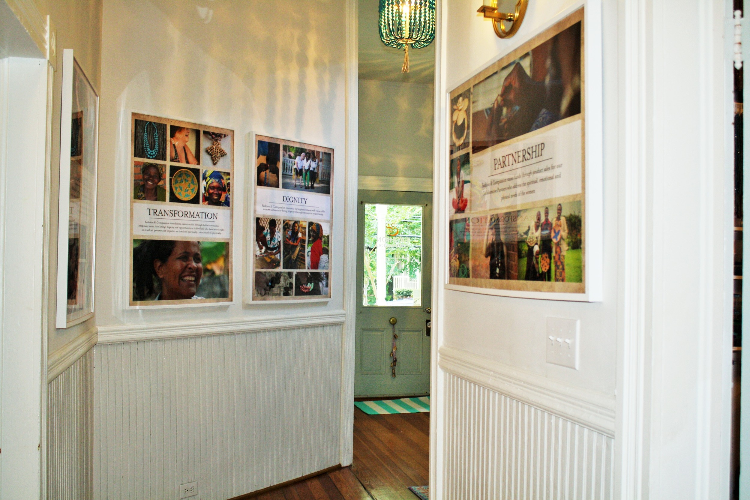 This is the view from the entryway, which features photos of the artisans and the core beliefs of the organization. I love all the details in the house, from the original doorbell to the old wood floors and all the wainscoting. How could you not be creative in a gorgeous place like this?