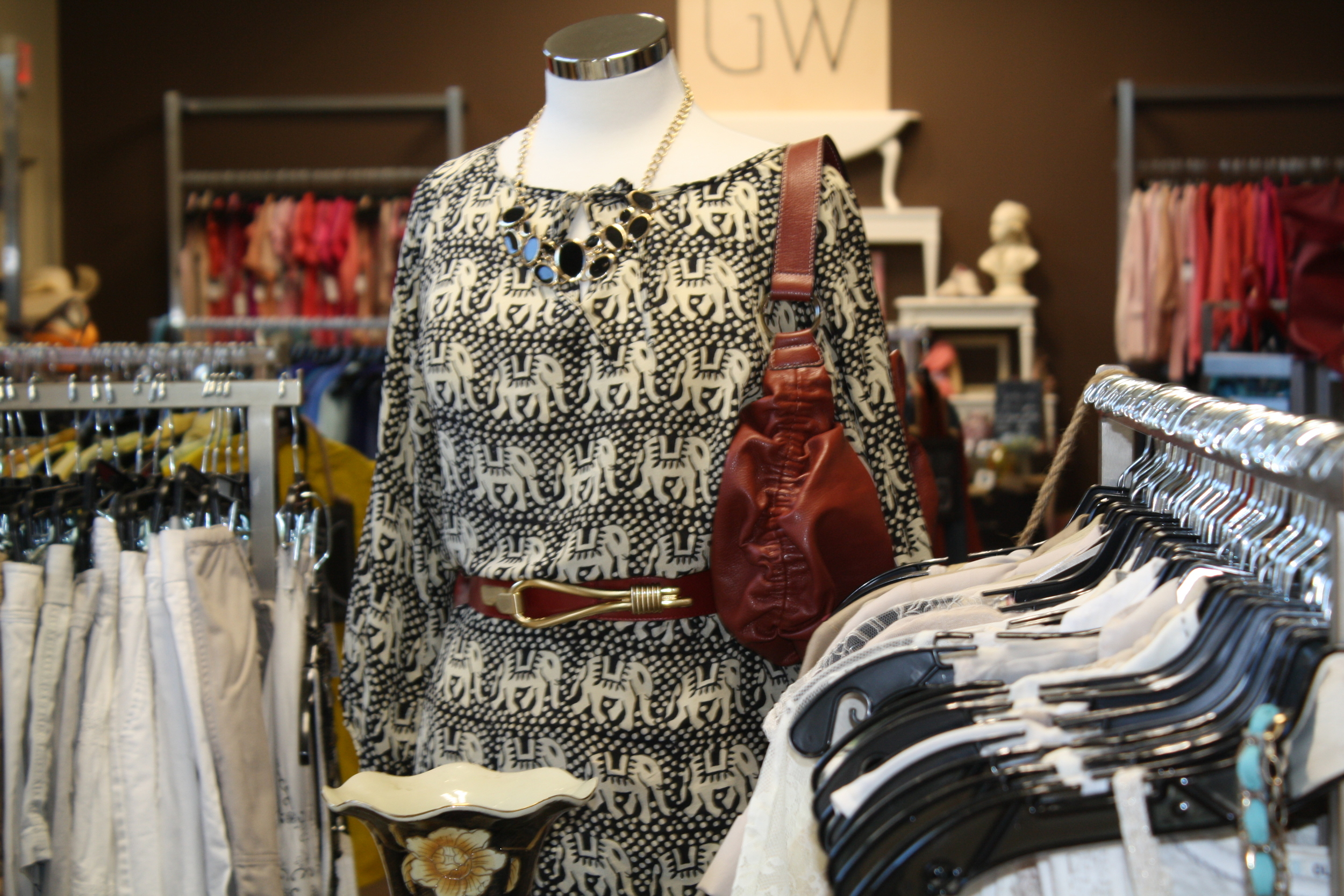 Elephant tunic, cognac belt and purse. Your next fave outfit. Done.