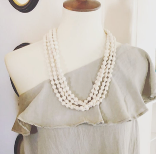 This one-shoulder beauty looks so great with the wooden beads!