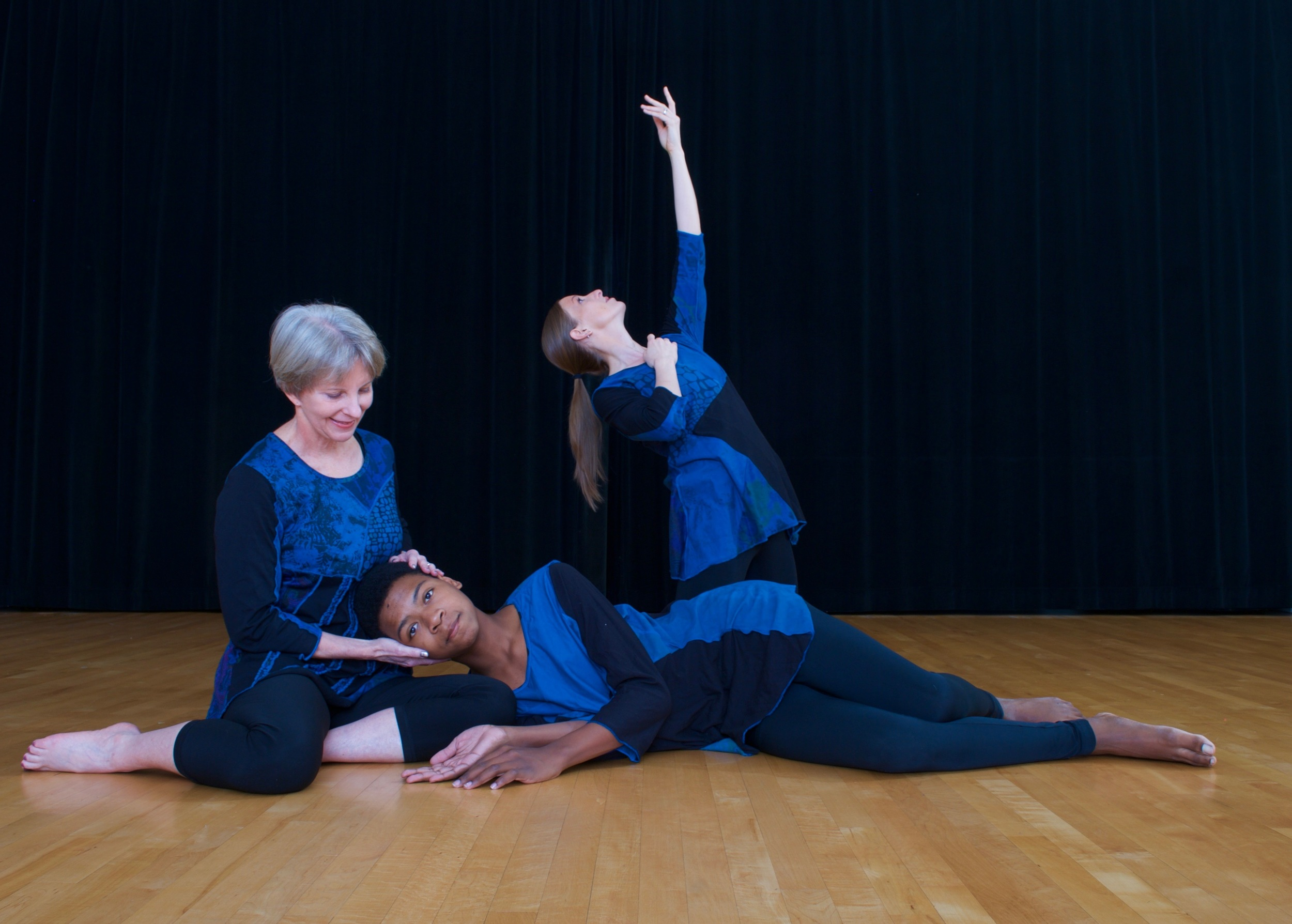 Dancers of all races and ages in a modern dance pose.