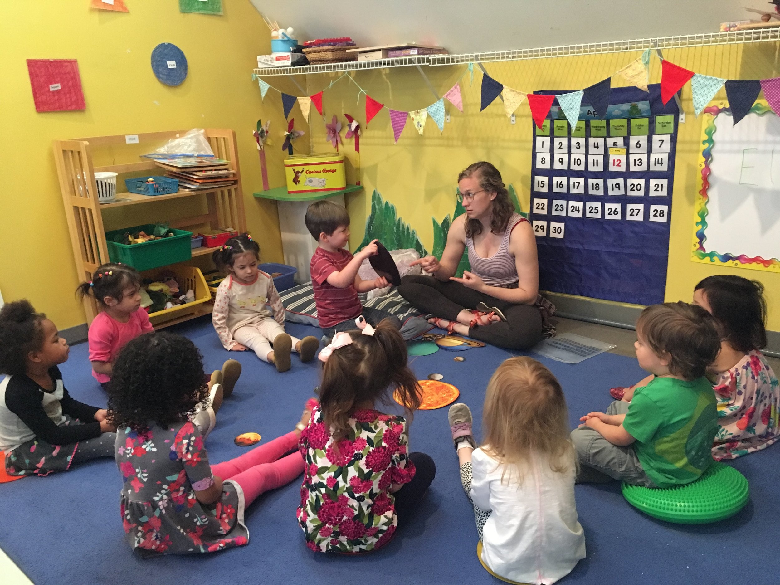 JESSI TEACHING THE YOUNG THREE'S IN OUR MULTI-ARTS PRESCHOOL.