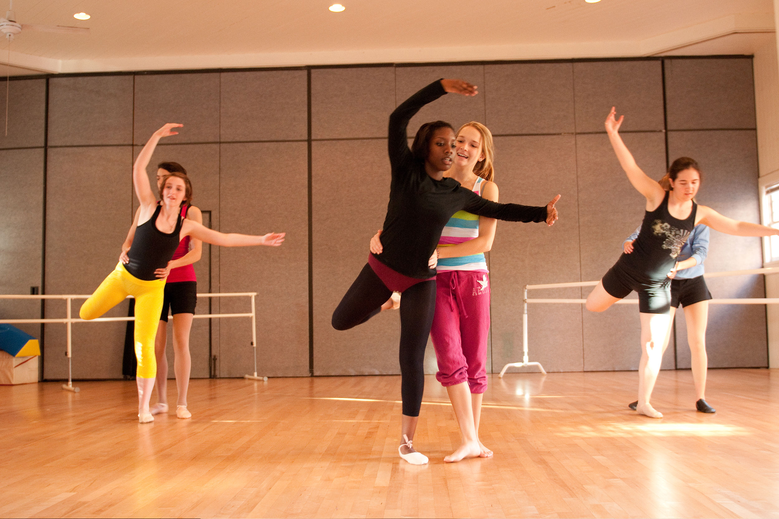 Ballet students practice their partner work with one another.