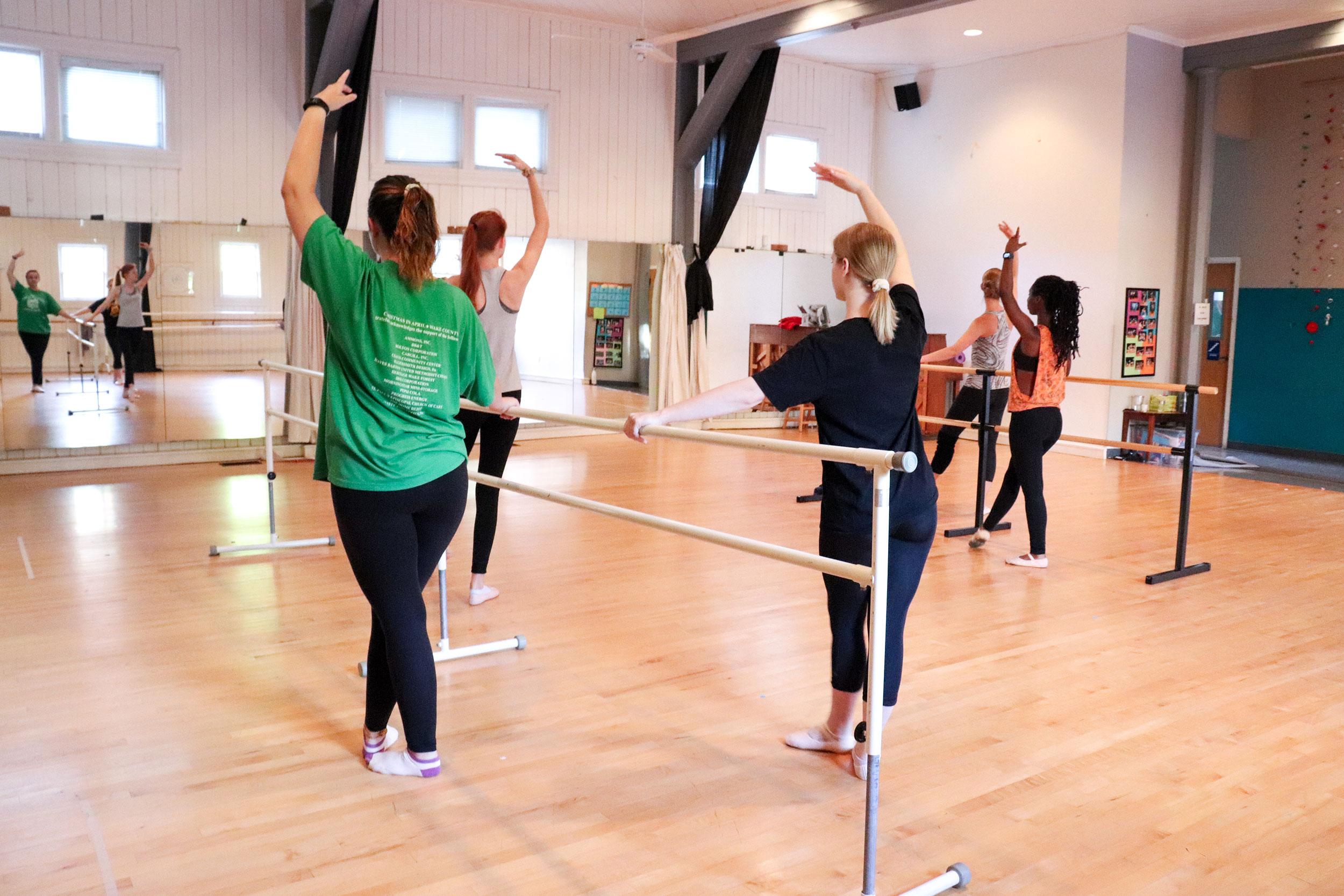 Ballet students practice at the barre.