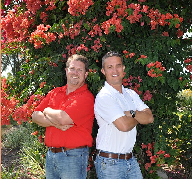 Blake Crawford, owner of Crawford Landscaping Group, and Keith Mahan, president and owner, project revenues will reach $13 million this year. Photo by Ed Clement