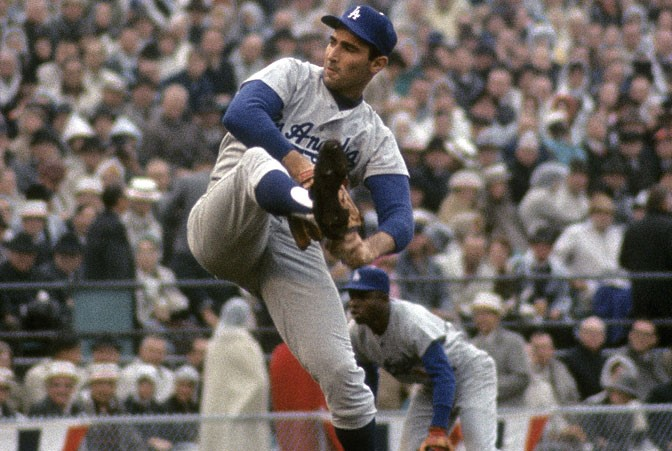 Sandy Koufax won the cy Young Award in 1963, '65, and '66.