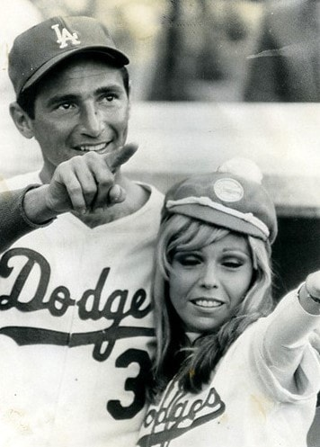 Sandy Koufax and singer Nancy Sinatra at Dodger Stadium in 1966.