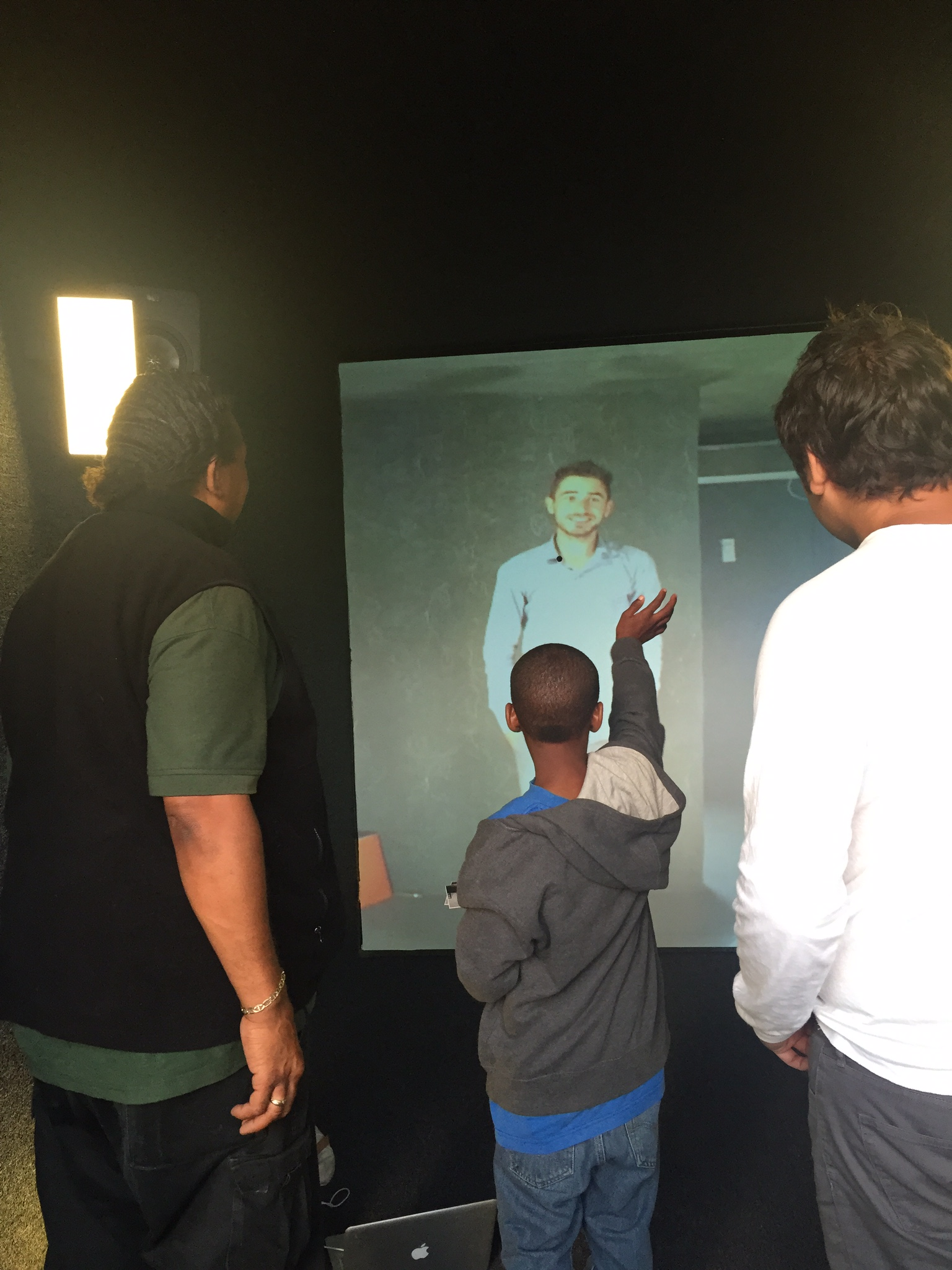 Young boy in San Francisco with Father and Amar C. Bakshi speaking to Herat Portal Curator Omid Habibi