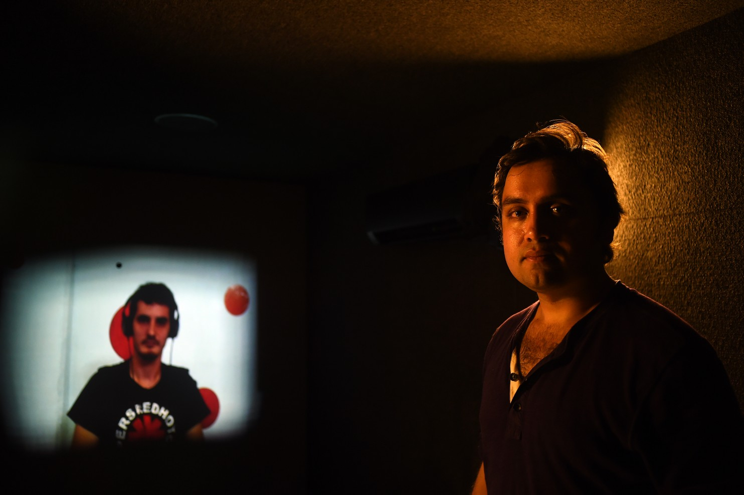 Artist Amar Bakshi, 31, created the Portals project, an audiovisual installation connecting visitors to one-on-one conversations with people in Tehran; Herat, Afghanistan; and Havana. (Astrid Riecken/For The Washington Post