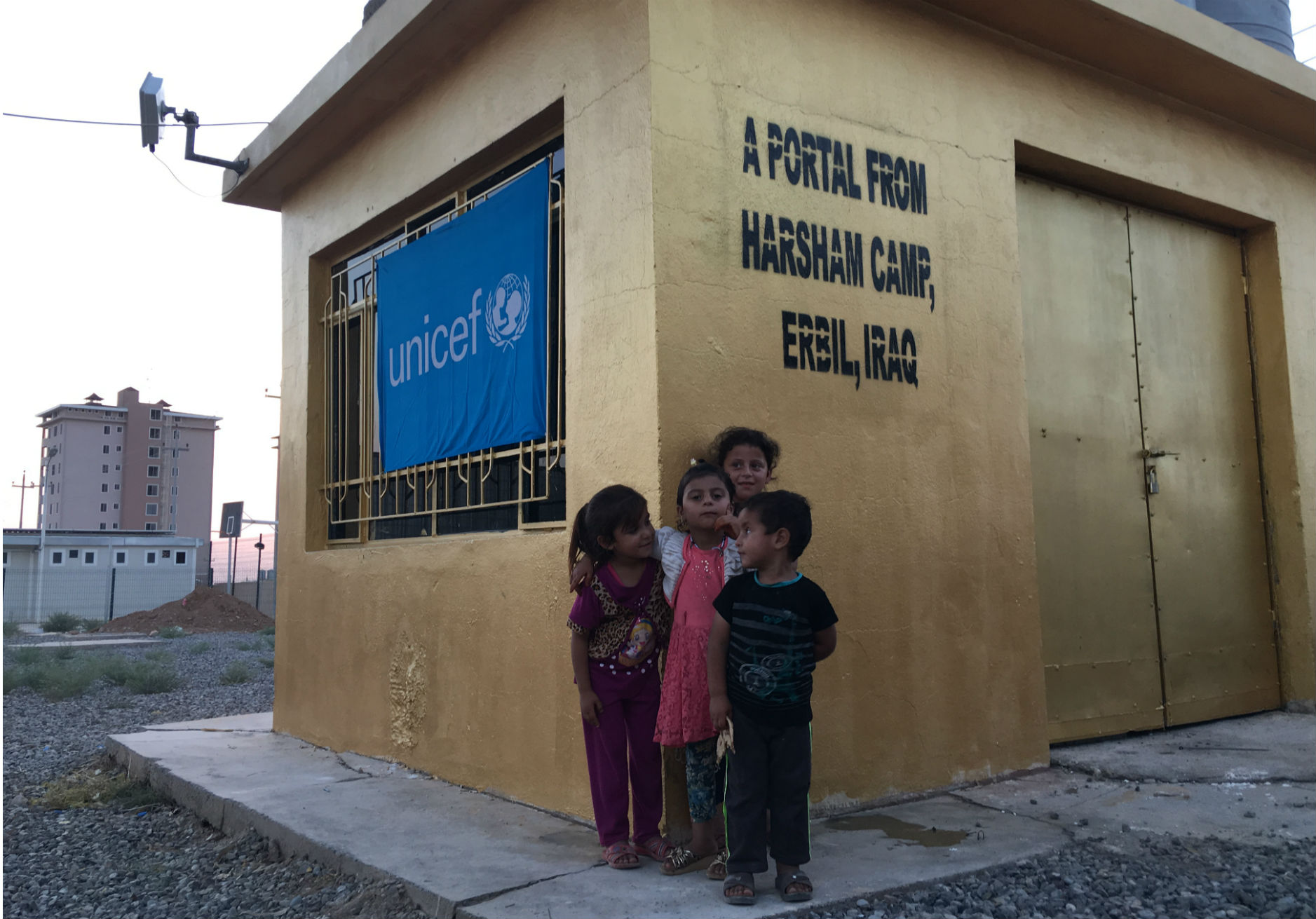 UNICEF Iraq/2016/Mackenzie Young Iraqi children outside the Portal in Harsham Camp in Erbil, Iraq. The Portal underwent a dramatic upgrade so that UNICEF could connect a young Iraqi entrepreneur with US President, Barack Obama.