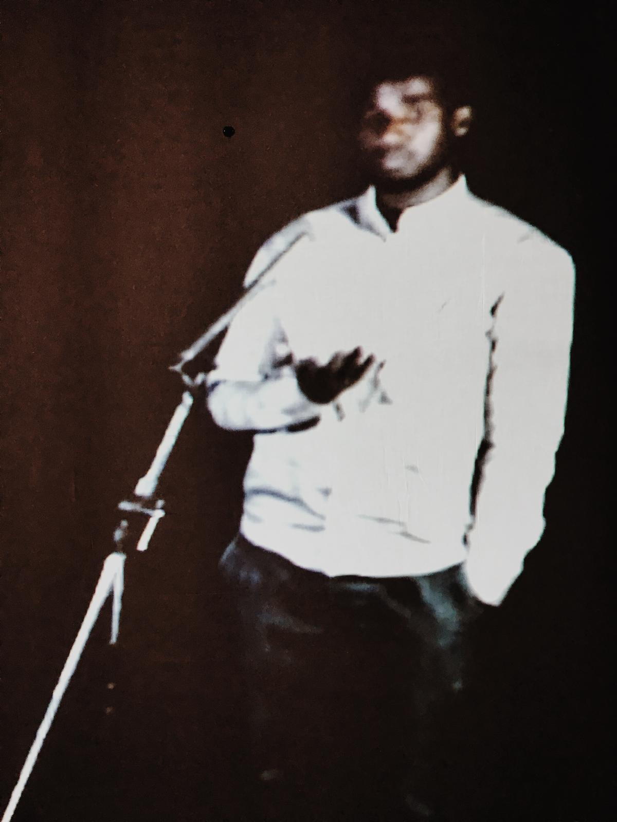 Dogon Nshimiyimana speaking through a portal in Kigali, Rwanda. CREDIT ALYCIN BEKTESH / ASPEN PUBLIC RADIO NEWS
