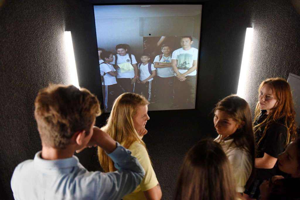 Greenwich Academy and Brunswick School students talk with students in Honduras using an audio/visual portal at Greenwich Academy in Greenwich, Conn. Thursday, Sept. 22, 2016. The portal, a large gold-painted cargo container, allows students to have a full-body Skype experience with people accessing other portals around the world. The portal will be at Greenwich Academy until December 15 and will link to portals in Honduras, Rwanda, Iraq, a community center in downtown Milwaukee and other locations.