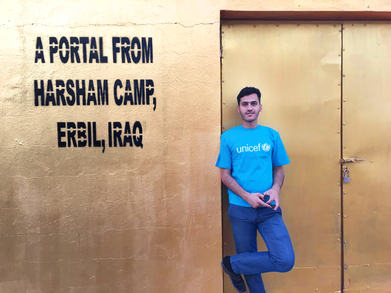 Entrepreneur in front of the Erbil Portal before speaking with President Obama