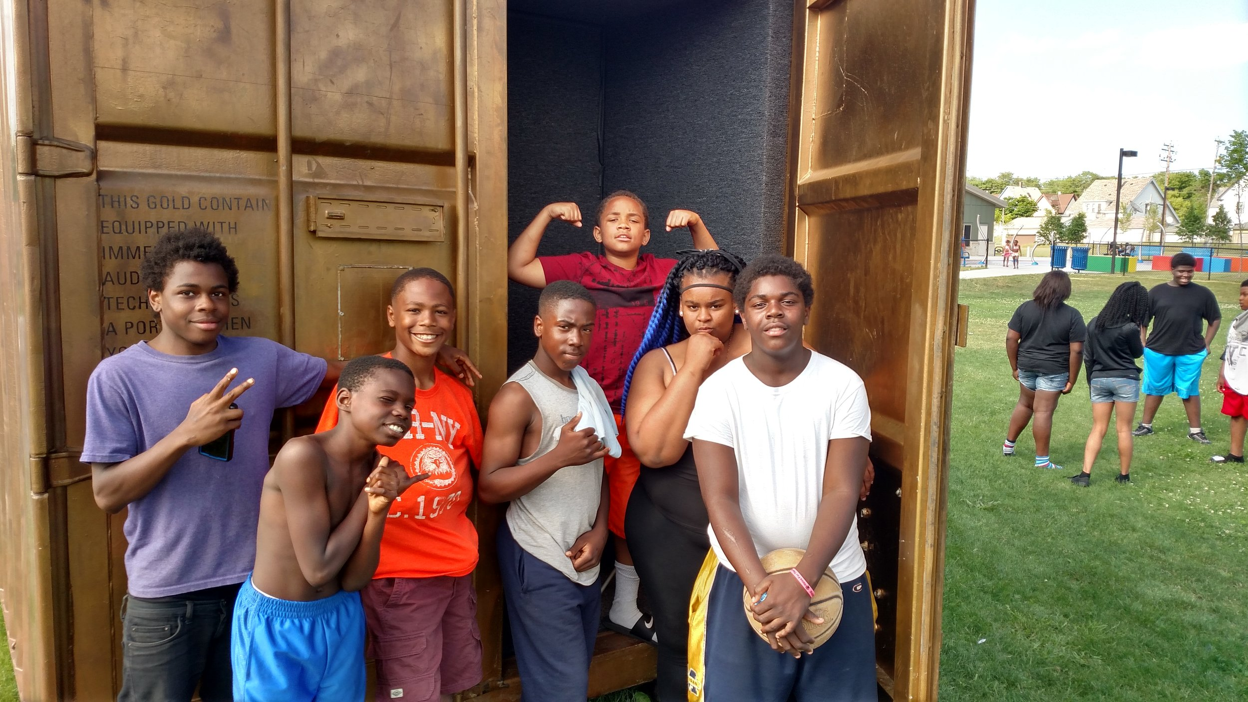 Young rugby players pose outside of the Milwaukee Portal after a sports dialogue