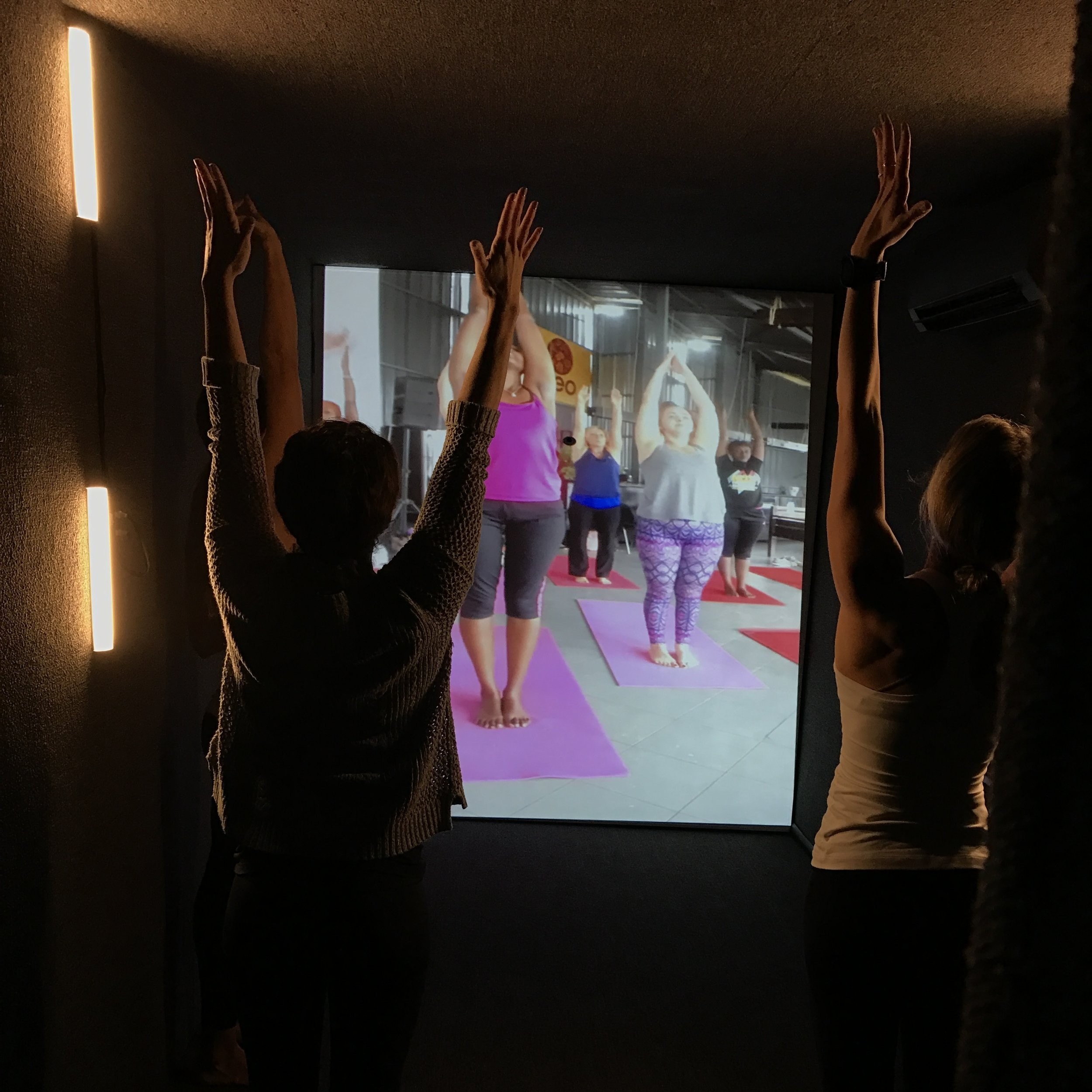 Yogis in Chicago and Kigali learn from one another and practice.