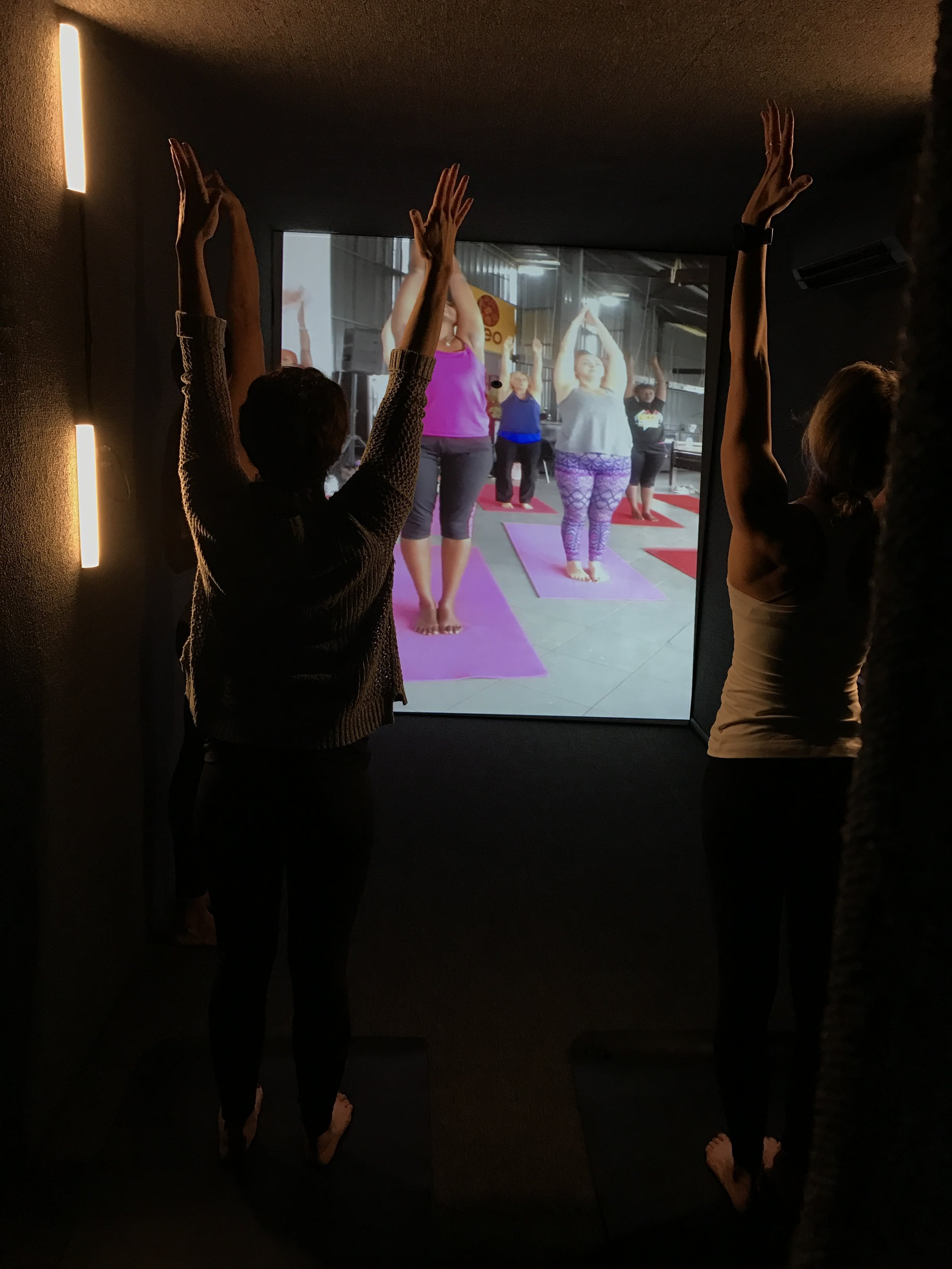 Portal yoga class between Kigali and Chicago